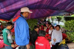 caritas-staff-speaking-with-evacuated-people